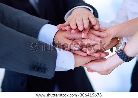 Business people with their hands together in a circle . - stock photo