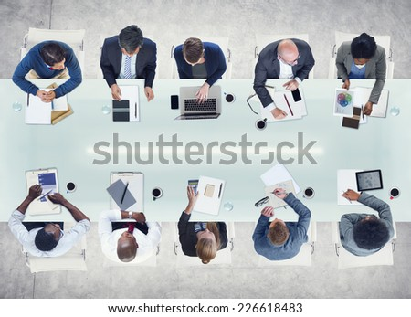 Business People Working Around a Conference Table - stock photo