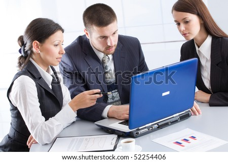 Business people working in team in the office - stock photo