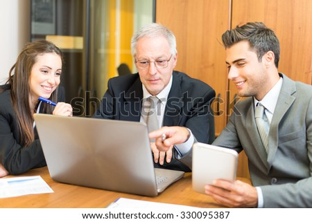 Business people working in their office - stock photo