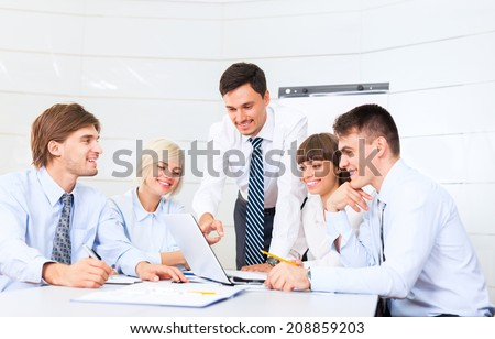 business people working looking to laptop screen, discussion on meeting, group businesspeople smile, team cooperation sitting at desk in office, communicate - stock photo
