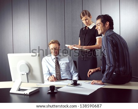 Business people working on computer in office - stock photo
