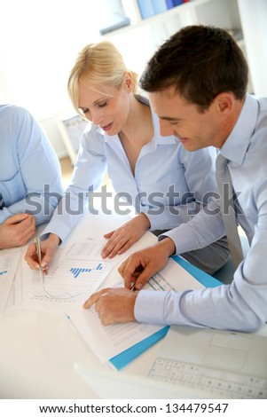 Business people working on financial project - stock photo