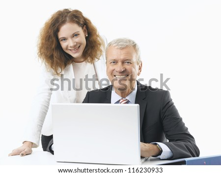 Business people working on Laptop - stock photo