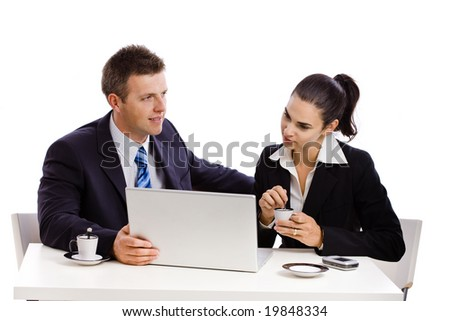 Business people working on laptop at desk, white background. - stock photo