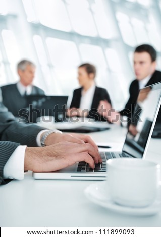 Business people working on laptop during the meeting - stock photo