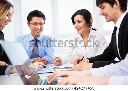 Business people working on new project at modern office - stock photo