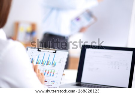 Business people working on project in office - stock photo
