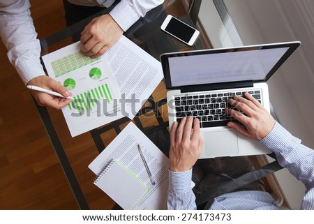 business people working on the table, top view - stock photo