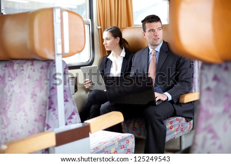 Business people working on the train - stock photo