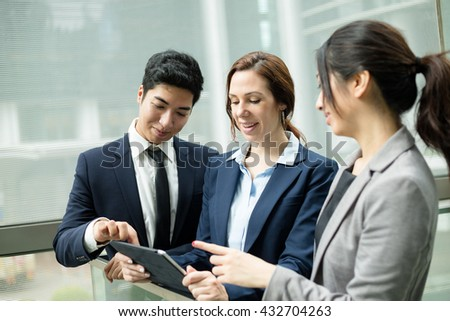 Business people working to tablet computer - stock photo