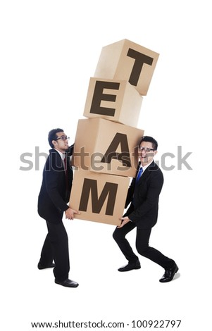 Business people working together in a team carrying card boxes isolated on white - stock photo