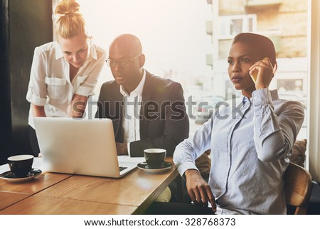 Business people working, using a laptop and cell phone. Meeting - stock photo