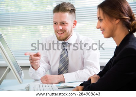 Business people working with computer in an office - stock photo
