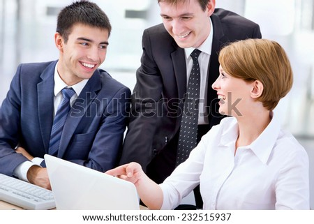 Business people working with laptop in an office - stock photo