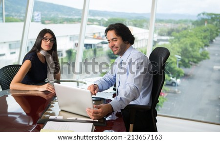 Business people working with laptop in  office - stock photo