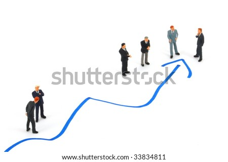 business peoples on economic chart background talking - stock photo