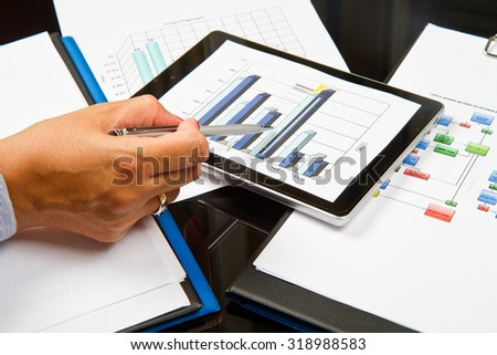 business person analyzing graphs  - stock photo