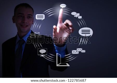 Business person pushing symbols on a touch screen interface - stock photo