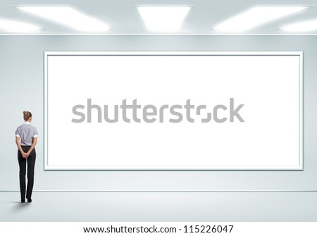 Business person standing near a white blank  billboard - stock photo