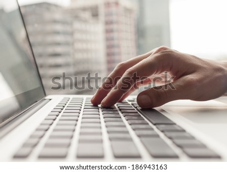 Business person using a laptop computer. - stock photo