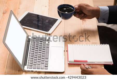 Business person using a laptop computer at the office.  - stock photo