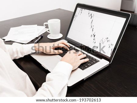 Business person using laptop in the office. - stock photo