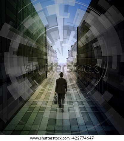 business person walks through passage, abstract image visual - stock photo