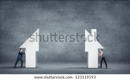 Business person with piece of puzzle ( jigsaw ) building a house - stock photo