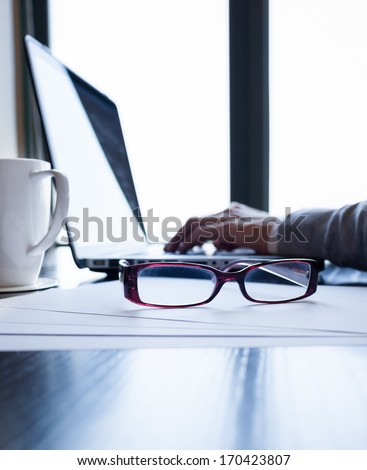 Business person working on computer - stock photo