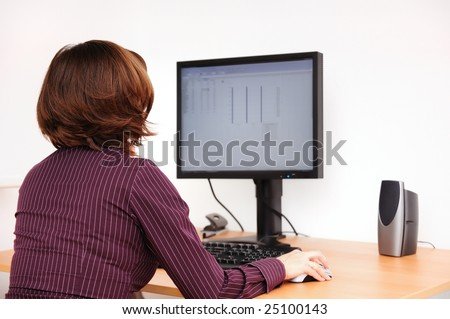 Business person works at table with computer - stock photo