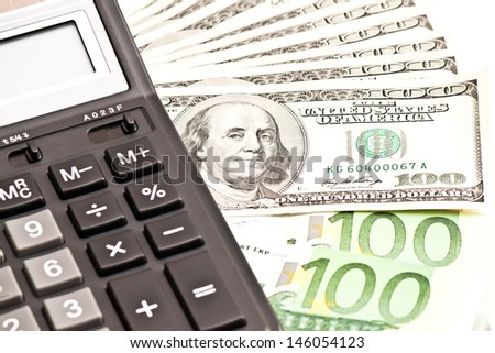 Business picture: money and calculator over white (selective focus) - stock photo