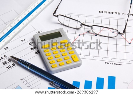 business plan concept - graphs, charts and calculator - stock photo