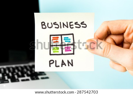 Business Plan on post-it note and swot concept, with notebook and blue background. - stock photo