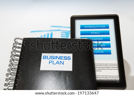 Business plan package includes printed booklet and digital presentation - stock photo