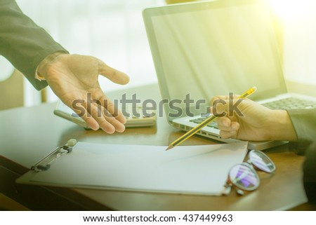Business plan,Team work process.Business people discussing the charts and graphs man hand working on laptop computer on office desk with social media network diagram,vintage color,selective focus - stock photo