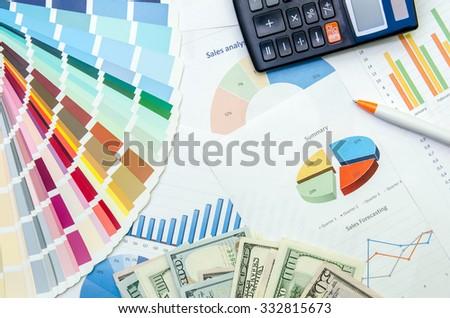 business plan with pen, dollar, calculator - stock photo