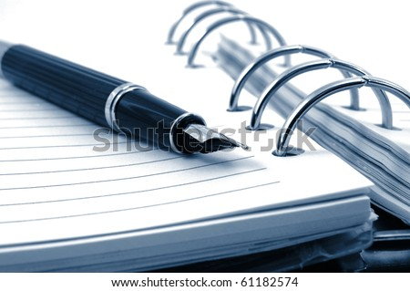 business pocket planner and pen ready to note an appointment - stock photo