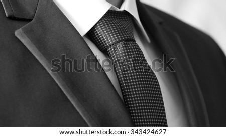 Business Power, Detail closeup - jacket men's, shirt with tie, monochrome image - stock photo