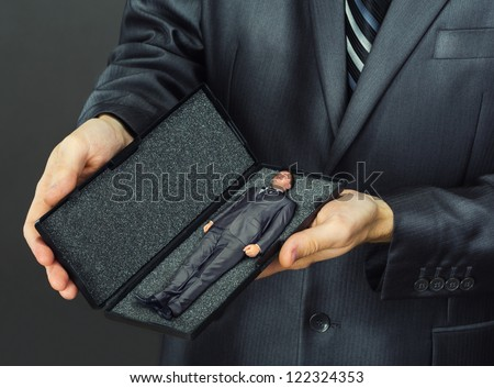 Business present - small businessman in box - stock photo