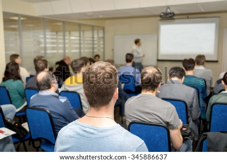 business presentation. adult students listening the trainer at the classroom - stock photo