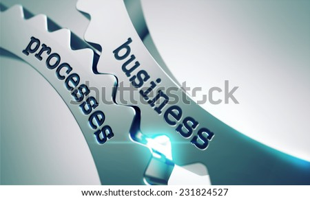 Business Processes on the Mechanism of Metal Gears. - stock photo