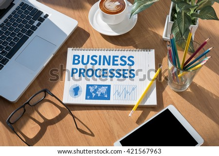 BUSINESS PROCESSES open book on table and coffee Business - stock photo