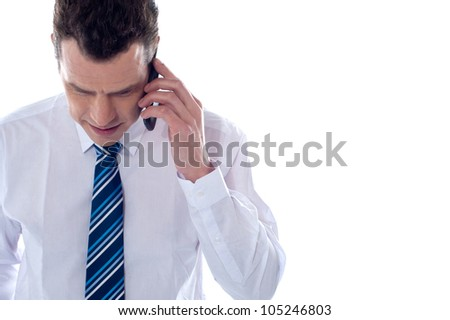 Business professional communicating on phone against white background - stock photo