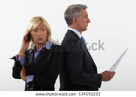 Business professionals standing back to back - stock photo