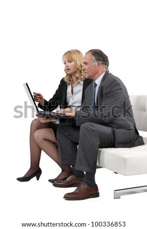 Business professionals working together on a project - stock photo