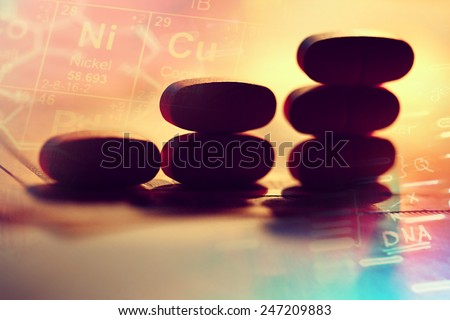 Business profit on pink pills on a dollar bill. - stock photo
