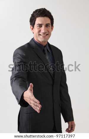 business raised arm focus on the hand - stock photo