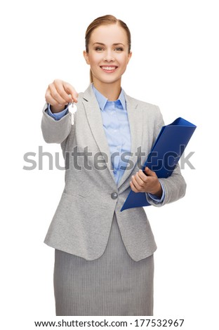 business, real estate, banking and office concept - smiling businesswoman with folder and keys - stock photo