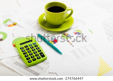 Business report. Cup of coffee on document. Accounting - stock photo